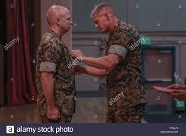 Brig. Gen. Roger Turner Jr., Commanding General, Marine Corps Air Ground  Combat Center, awards Col. Timothy Barrick, off-going commanding officer,  Marine Corps Tactics and Operations Group, with the Legion of Merit in