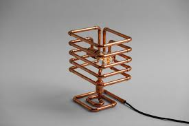 industrial cage table lamp made of copper pipes with tesla bulb inspired by steampunk design