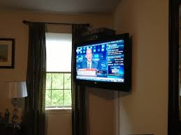 tv mounting in the corner of the wall with full motion tv mount