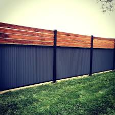 corrugated fence custom privacy fence built out of metal post tiger wood and corrugated metal remodel