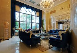 luxury formal living room with dark blue fabric furniture high ceiling with crystal chandelier