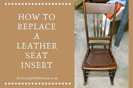 a leather seat in an antique chair