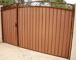 decorative arched unevenly split rv gate with the rust and rustic cedar combination iron gates wood68
