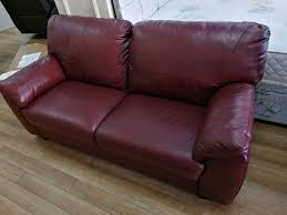 red wine coloured 3 seater real leather sofa with wooden legs