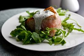 grilled albacore with yogurt dill sauce on a bed of arugula
