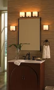 bathroom bathroom vanity light fixtures with wooden cabinet and mirror also black towel hanger and light as well as over mirror bathroom lights also mirror