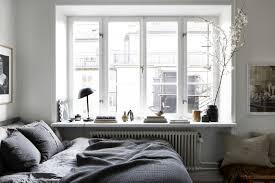 cozy scandinavian style bedroom nook with big window