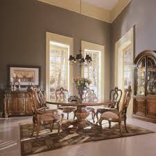 carved round table dining set villa cortina