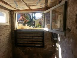 i removed my temporary ply i glazed the window repair and painted all 12 sides of the window i secured it at the top on one side with a locking barrel