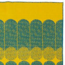 modern graphic midsummer wool throw blanket in yellowdusty blue