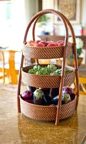 large three tiered rattan basket with enough depth and weight to hold heavy fruits vegetables countertop