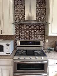dramatic tin backsplash contemporary kitchen