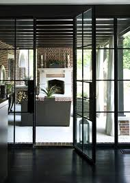 Black metal french doors, perfect transition indoor/outdoor living ...