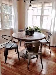 blanca dining table from world market vine tabouret stacking chairs from overstock