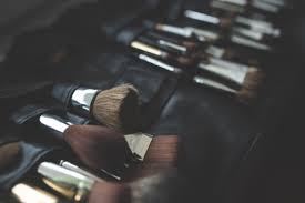 hand finger black makeup make up close up eye organ brushes firearm