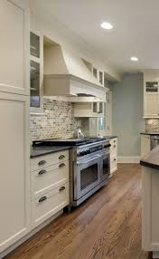 off white with large range hood black granite countertop new decorating ideas