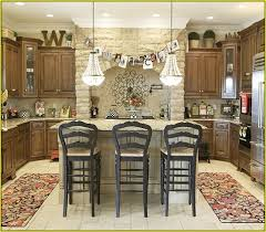 decorating above kitchen cabinets tuscan style for your kitchen ideas