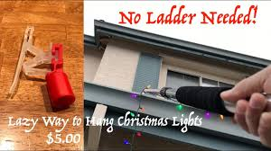 Best Way To Hang Christmas Lights 5 00 The Lazy Way To Hang Christmas Lights On The Gutter No Ladder Needed Laderlless Light Clips
