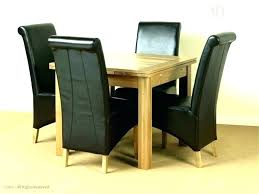 extending dining table sets round