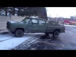 old green army dodge 4 door ram