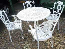 lovely old cast metal garden table and 4 chairs