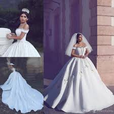 Beaded Designer Wedding Gowns 2018 Designer Arabic Luxury Wedding Dresses Off Shoulder Beading Appliques Ball Gown Wedding Gowns With Long Train Lace Up Back Bridal Dress Ball