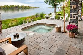 an amazing pation by the river should definitely feature an in ground hot tub