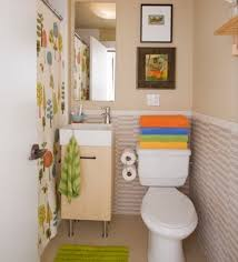 small bathroom decorating ideas color. colorful printed shower curtain with small bathroom decorating ideas using beige wall color and frameless mirror p