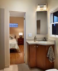 bathroom ideas round modern corner bathroom sink with storage under small mirror and two bulbs