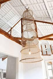 diy pendant lamp made from an antique fishing basket lighting