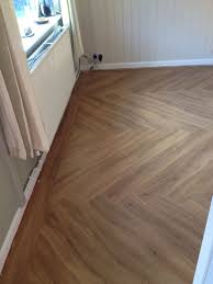 polyflor colonia house oak ed in a herringbone pattern with a straight border