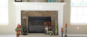 an electric fireplace insert with a classic elegant white mantle