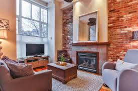 the brick wall is centred with a cozy gas fireplace