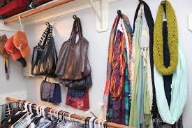 purse organization hang purses on hooks via roomandbath com