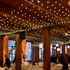 the lighting loft. a canopy of string lights suspended with c7 bulbs over center are the main floor lighting loft