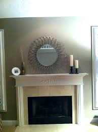 round mirror over fireplace mantel mirrors mantels mantle ideas