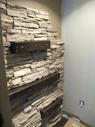 installing faux stone on the accent wall via faux stone wall panels 7 chic stone gorgeous interior stone wall interior faux