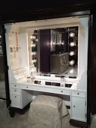 large modern makeup vanity dressing table with glass top and drawer plus makeup storage painted with white color plus lights around mirror ideas