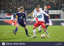BRUSSELS, BELGIUM - NOVEMBER 24: Kristof D'Haene of Kv Kortrijk battles for  the ball with Yari Verschaeren of Anderlecht during the Jupiler Pro League  match day 16 between RSC Anderlecht and KV