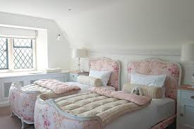 pink shabby chic girls bedroom with french beds