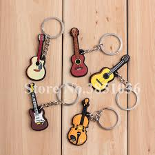 100pcs lot novelty silicone electric clical guitar ukulele shaped keychains instrument keyrings for