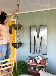 diy crafts how to hang planter flower baskets to decorate your back patio