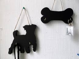 A unique handmade design of a DOG BONE shaped chalk board with hooks to  form a