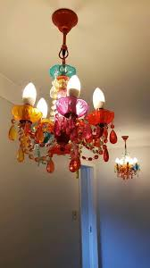 2 multi coloured chandeliers light fittings