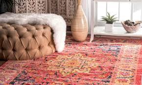 tufted ottoman on traditional persian rug