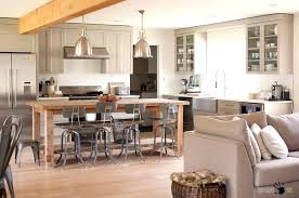 vine open kitchen with big windows along wooden breakfast console sofa table stools bar behind couch