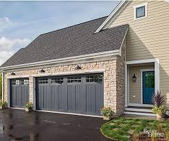 House On Gray Wood Look Garage Doors Pilotprojectorg
