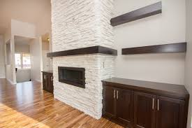alpine ledgestone linear fireplace unit with custom built ins and a boxed wrap around mantel