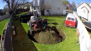 in ground trampoline. Timelapse Footage Of An In-Ground Trampoline Being Installed In A Backyard Ground
