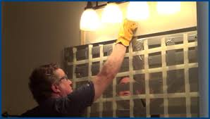 how to remove glued mirror from bathroom wall